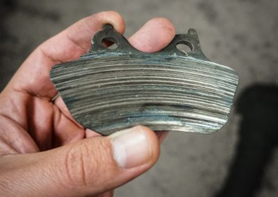 "Hmmm... these brake pads are going on the ""wall of shame"""